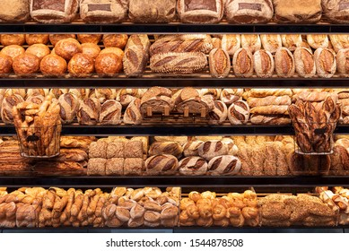 Delicious loaves of bread in a german baker shop. Different types of bread loaves on bakery shelves.