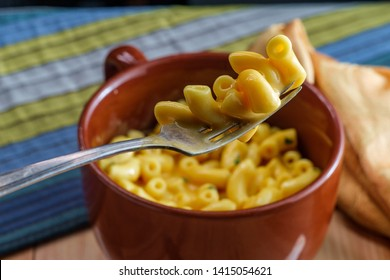 Delicious macaroni and cheddar cheese in a bowl
