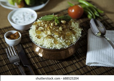 Delicious Malabar Dum Biriyani, Kerala, Indian food, chicken biryani, Chicken pulao seasoned with mint leaves, basmati rice, herbs, raita, Ramadan, Eid