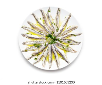 Delicious Marinated anchovies with parsley, olive oil and vinegar isolated on white background.