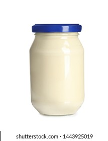Delicious mayonnaise sauce in glass jar on white background