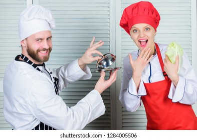 Delicious meal. Culinary surprise concept. Woman and bearded man culinary show team. Ultimate cooking challenge. Culinary battle of two chefs. Kitchen rules. Couple compete in culinary arts.