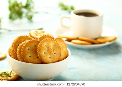Delicious meal -salted  cheese crackers biscuits and cup of hot black coffee.