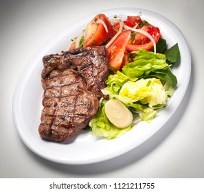 delicious meat dish with salads