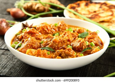 Delicious meat korma served with paratha -Indian cuisine.