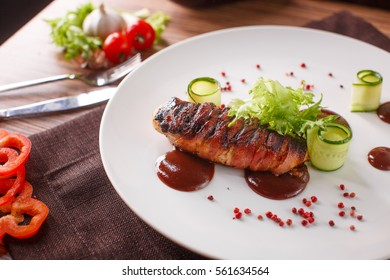 Delicious meat loaf with ketchup on a white plate, macro horizontal