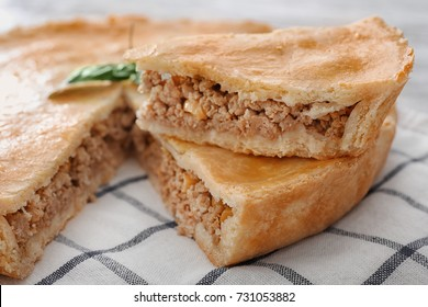 Delicious meat pie on table