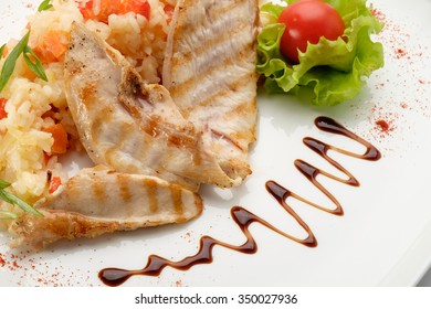 Delicious meat salad prepared by a professional chef in a restaurant, on a white background.
