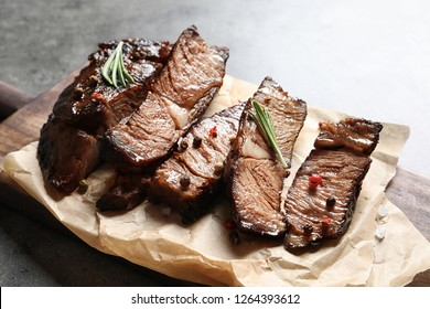 Delicious meat served for barbecue party on gray table