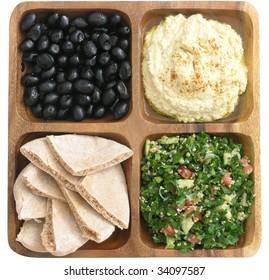 delicious Mediterranean food: kalamata olives, hummus, tabouleh, and pita bread