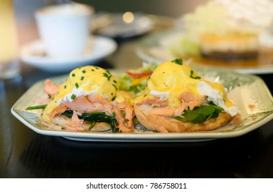 Delicious menu with Free range poached eggs, Scottish smoked salmon, sauteed spinach and hollandaise sauce on toasted muffin, Egg Benedicts with Salmon served with spinach salad