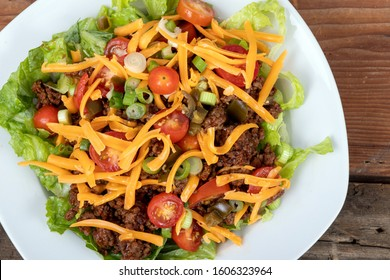 delicious mexican beef taco salad bowl dish closeup on wood table