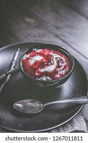 Delicious milk rice with raspberry sauce and vanilla freshly prepared