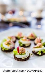 Delicious mini sandwiches on a white plate.