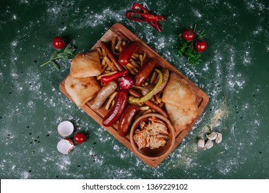 delicious mix of sausages on a wooden plate