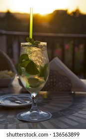 A delicious Mojito cocktail on a hotel terrace at sunset