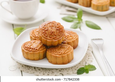 Delicious Mooncake, a kind of traditional Chinese Snack for Mid-Autumn Festival on the Table.
