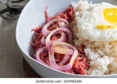 delicious morning breakfast corned beef with egg on top of rice