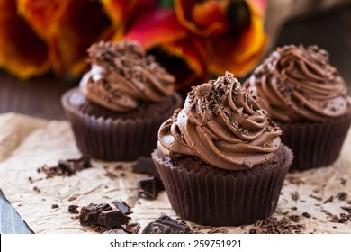 Delicious Mothers day  chocolate cupcakes  with spring tulips
