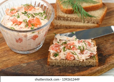 Delicious mousse, riyet, pate, dip of Smoked Salmon (trout), Cream Cheese, dill and horseradish on Rye Bread Slices. Gourmet appetizer. Selective focus