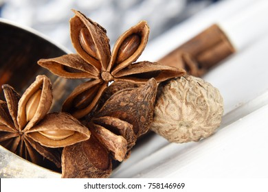 Delicious mouth-watering condiments and spices on isolated background sticks cinnamon cardamom nuts, and nutmeg