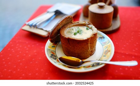 Delicious mushroom cream soup served in bread loaf bowl. National Lithuanian dish. Tradicional Lithuanian cuisine.