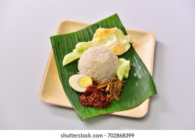 delicious nasi lemak full concept with banana leaves