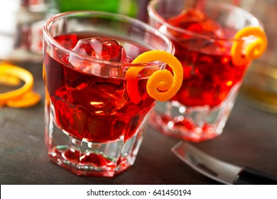 Delicious negroni cocktails with campari, gin, vermouth, and a citrus orange twist.