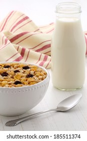 Delicious and nutritious breakfast muesli or granola cereal with milk on vintage styling.