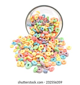 Delicious and nutritious fruit cereal loops flavorful in glass bowl on white background