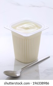 Delicious, nutritious and healthy fresh plain yogurt cup. On vintage Italian carrara marble retro styling.