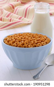 Delicious and nutritious lightly toasted breakfast honey nuts cereal loops on vintage styling
