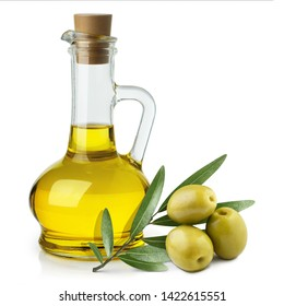 Delicious olive oil in a glass bottle and green olives with leaves, isolated on white background