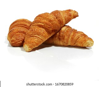 delicious ond crispy croissants on white