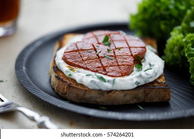 Delicious open sandwich made with grilled sausage (Turkish sucuk)