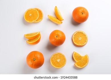Delicious oranges on white background, flat lay