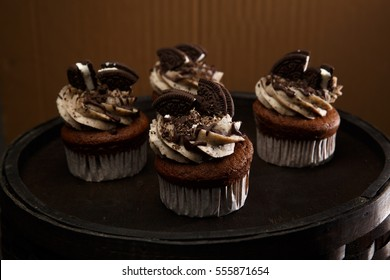 Delicious Oreo cupcakes on dark background. selective focus