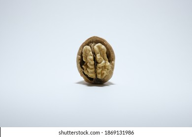 Delicious organic walnut with nutshell from top view isolated on a white background