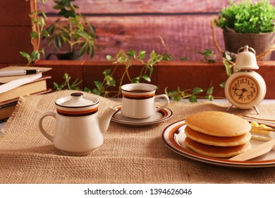 Delicious pancakes and a cup of coffee.