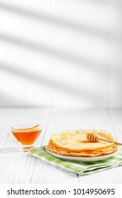 Delicious pancakes with honey on the table. The concept of food, breakfast,  pancake week.