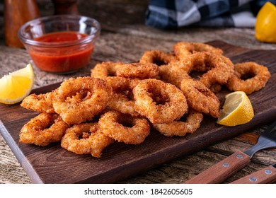 Delicious panko and black pepper crusted calamari rings with spicy marinara dipping sauce.