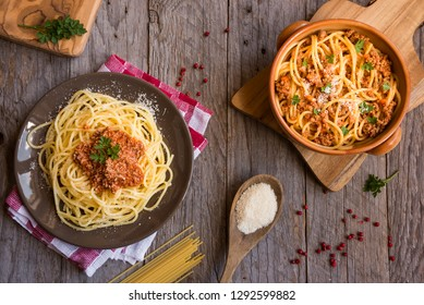 Delicious pasta with bolognese sauce on dark wooden table