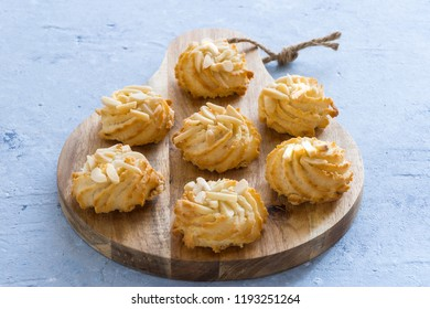 Delicious pastry with almond on blue background
