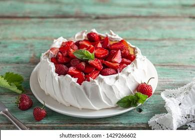 delicious Pavlova cake with fresh strawberry, seective focus