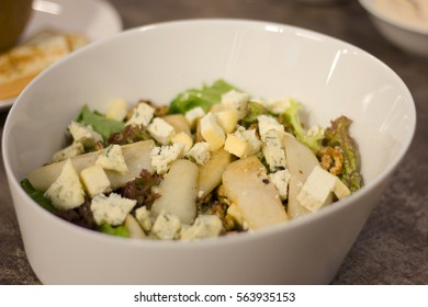 delicious pear and walnut salad with honey, blue cheese and salad leaves.
