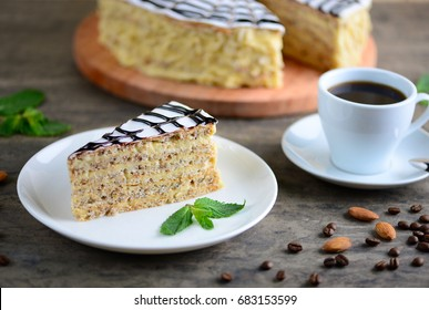 Delicious piece of esterhazy cake (torte). Morning cup of coffee with dessert. Background with a copy space.