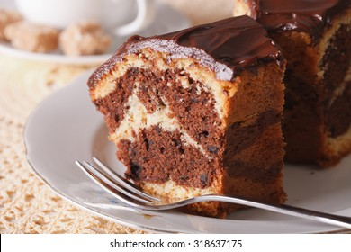 delicious piece of marble cake with chocolate macro on the table. horizontal