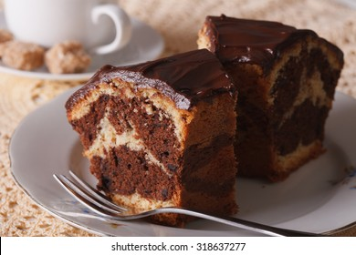 delicious piece of marble cake with chocolate macro on a plate. horizontal