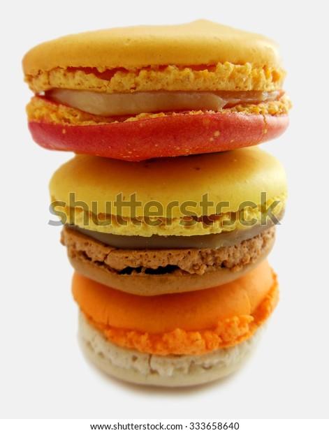 Delicious pile of three citrus flavored macaron desserts
