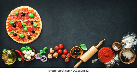 Delicious pizza with ingredients and spices. Top view with copy space on wooden table